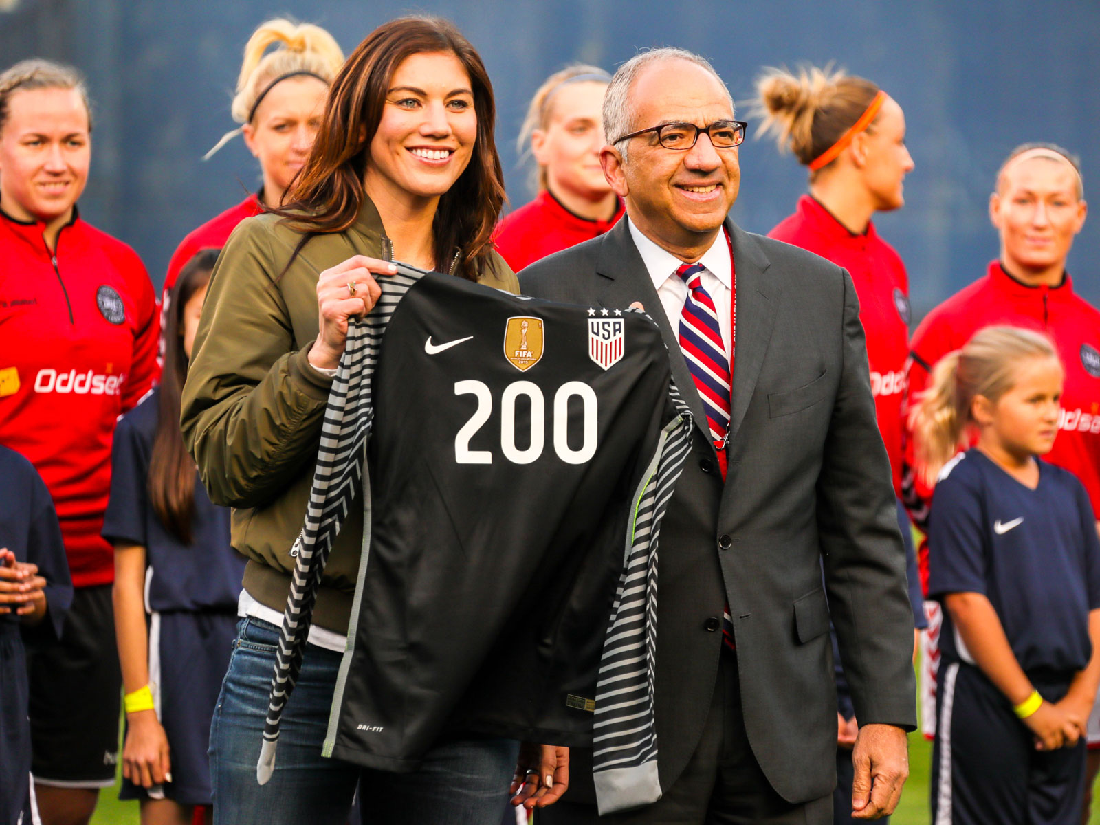 Hope Solo and U.S. Soccer president Carlos Cordeiro