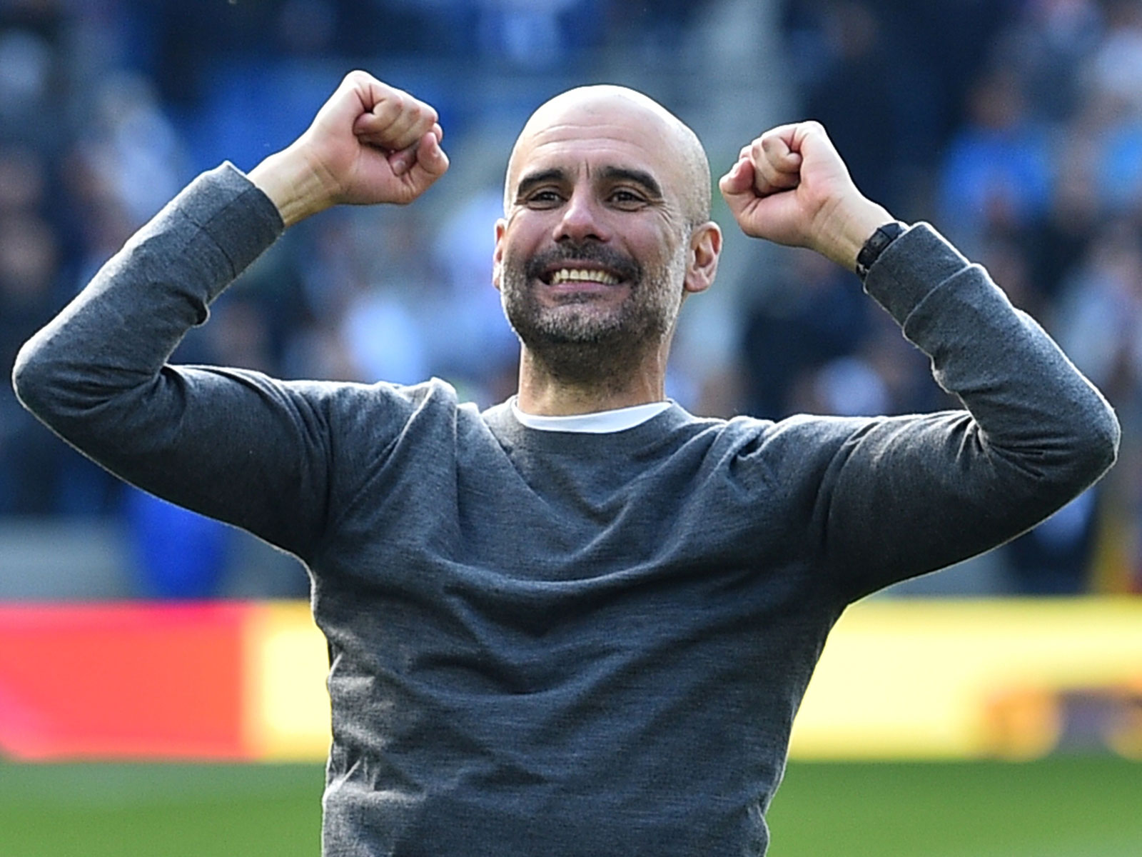 Pep Guardiola celebrates Manchester City's Premier League title