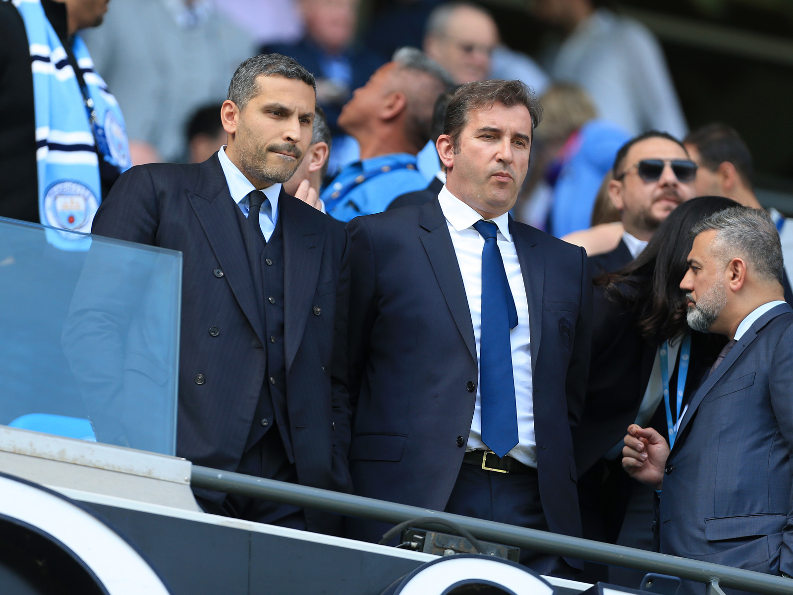 Man City executives look on at the Etihad