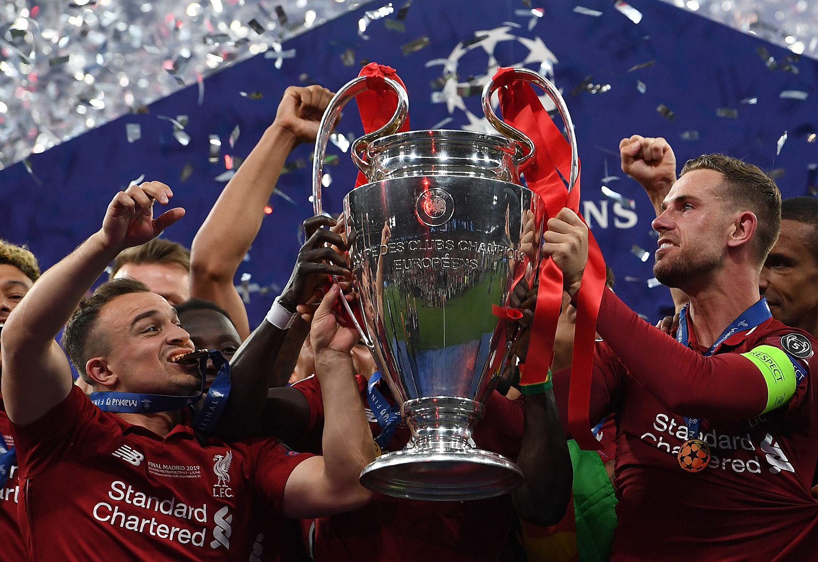 Liverpool captain Jordan Henderson lifts the Champions League trophy