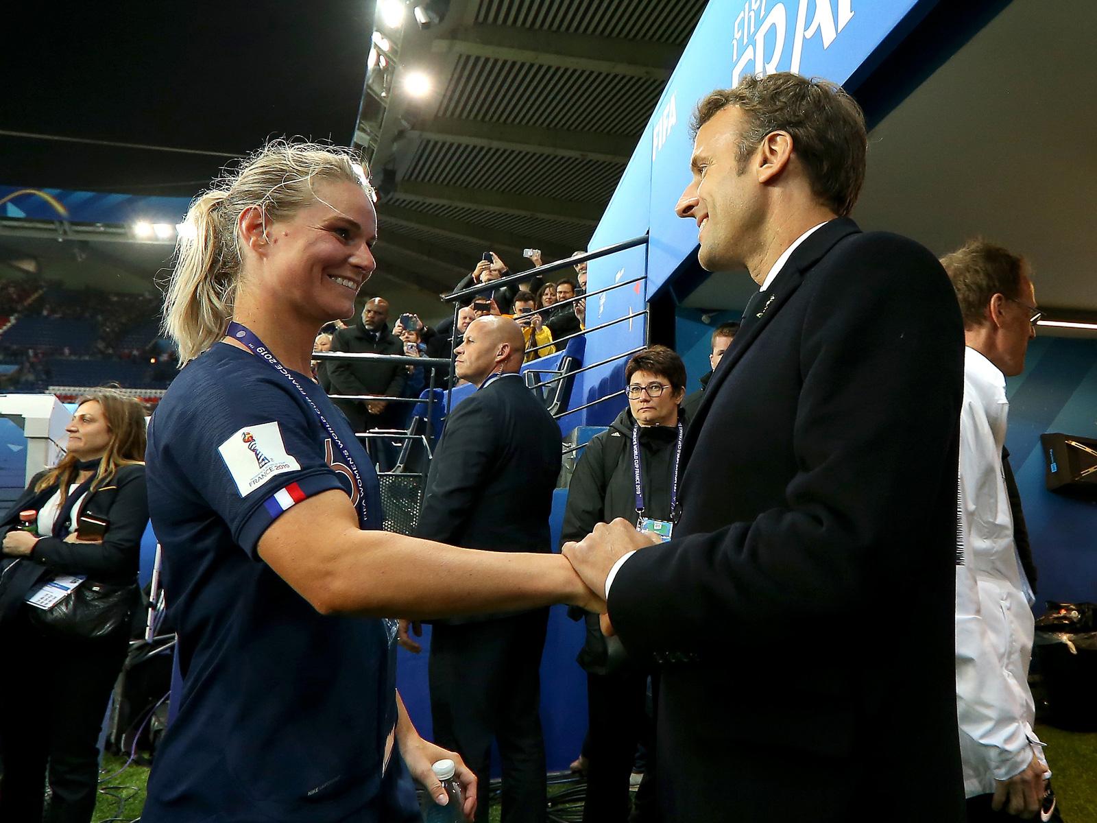 France president Emmanuel Macron congratulates Amandine Henry at the Women's World Cup