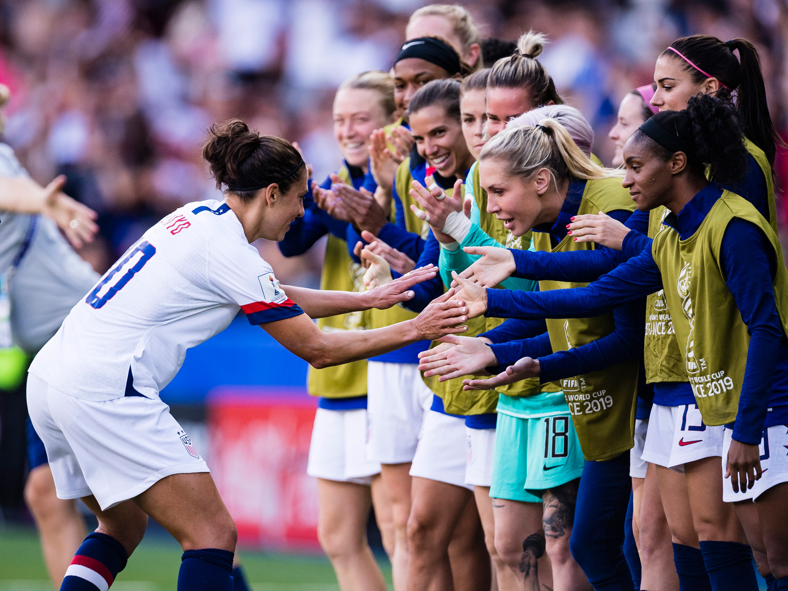 Carli Lloyd celebrates her goal vs. Chile with her USA teammates