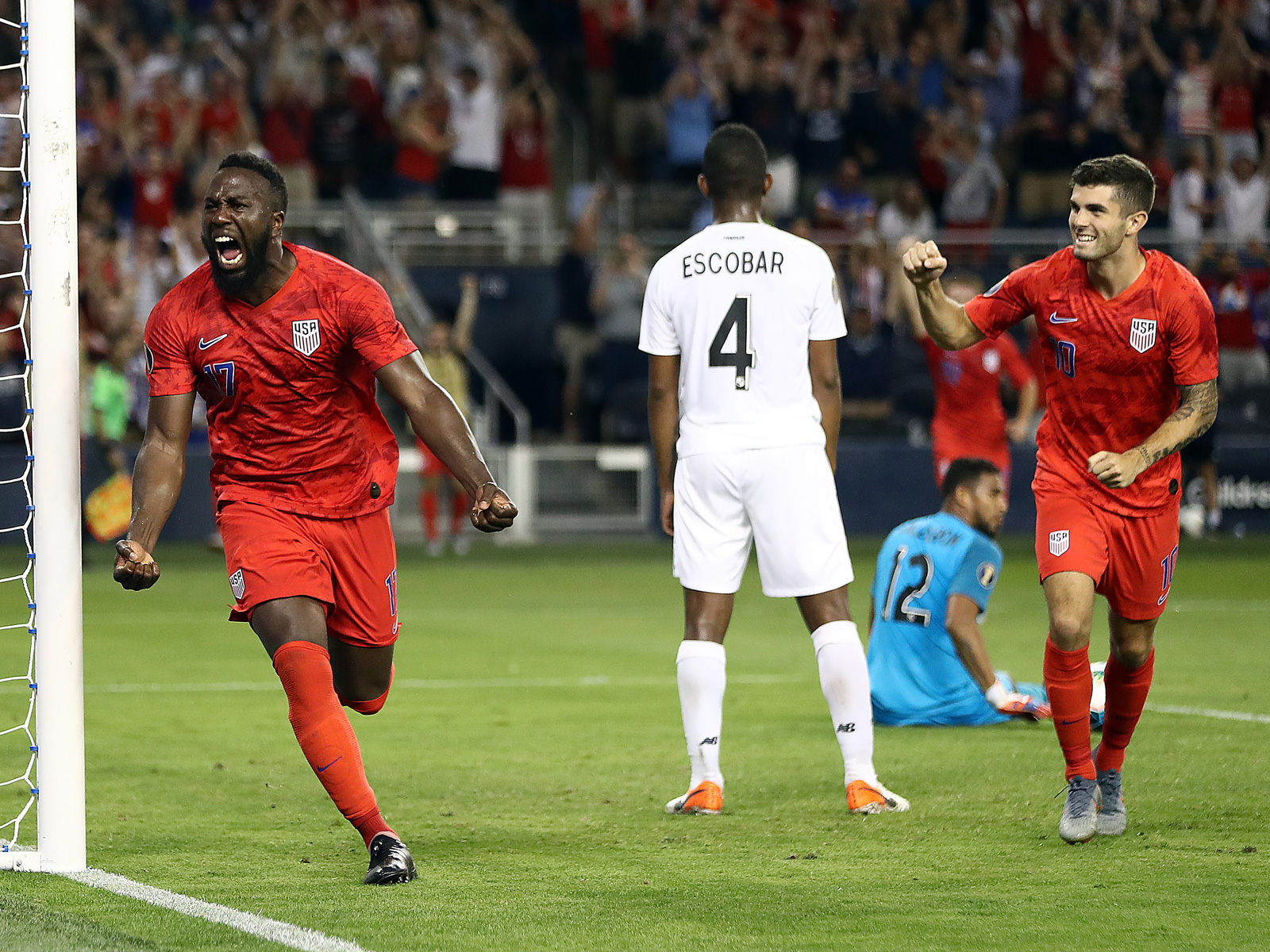 Jozy Altidore and Christian Pulisic celebrate the USA's goal vs. Panama