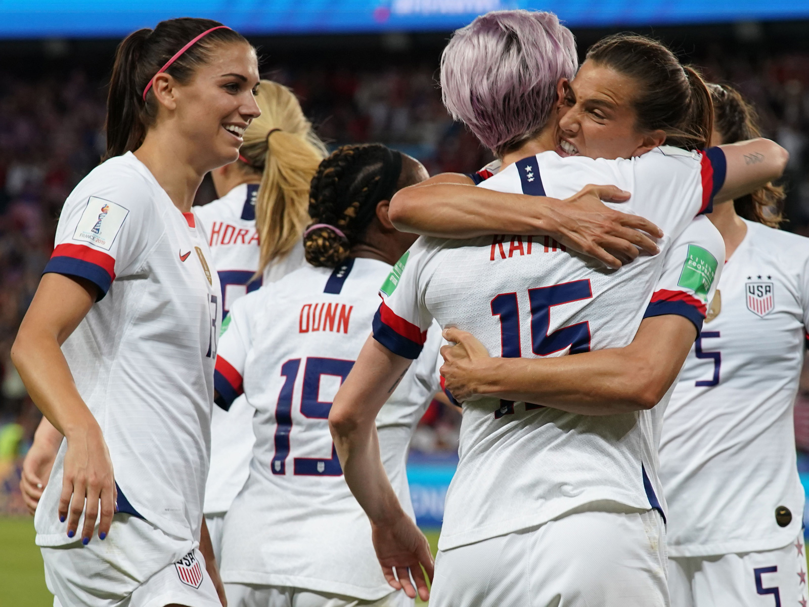 Megan Rapinoe is hugged after scoring vs. France at the Women's World Cup