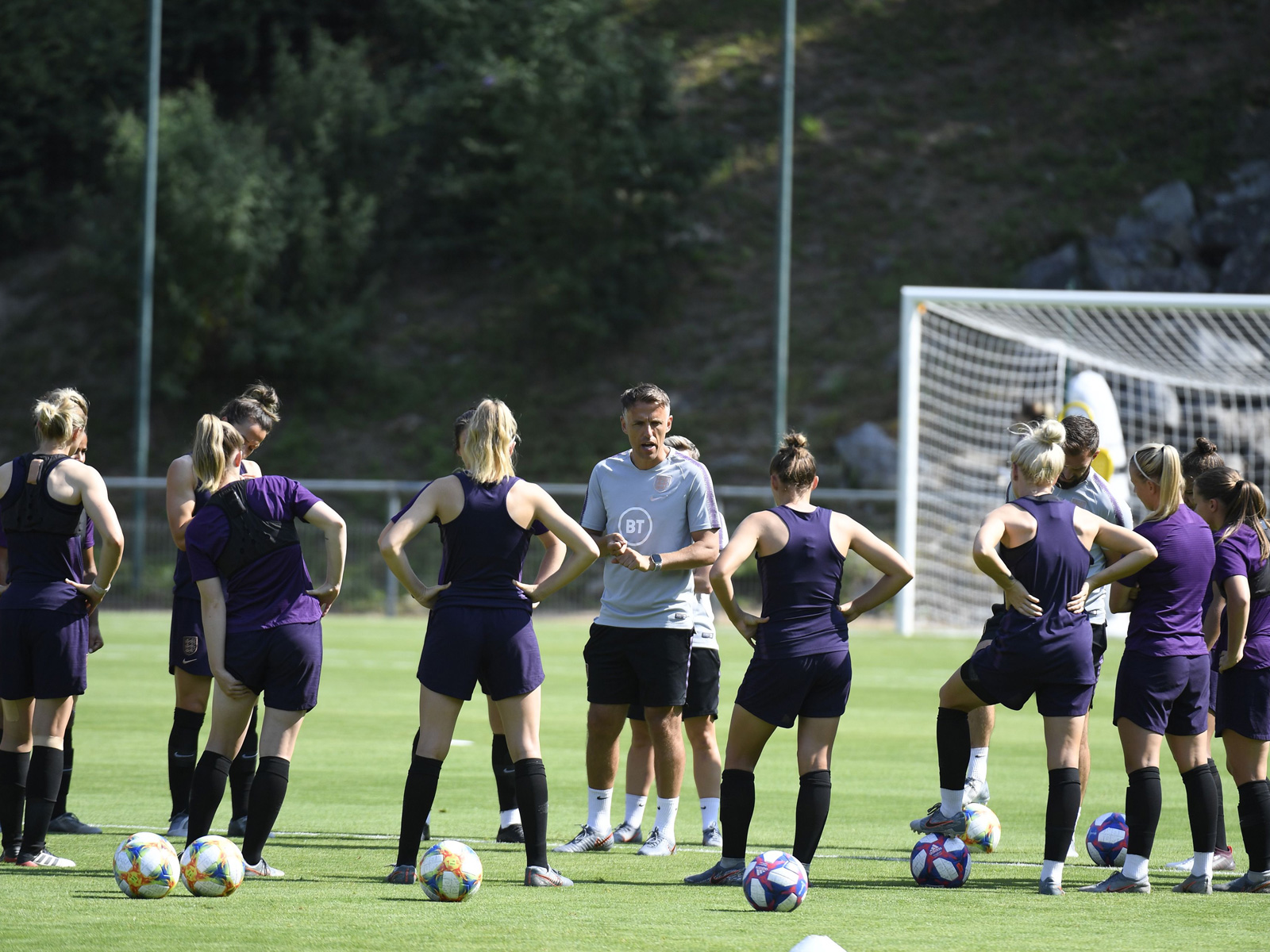 England coach Phil Neville leads training before the Women's World Cup semifinals