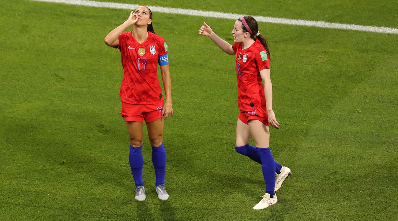 Alex Morgan celebrates her goal vs England