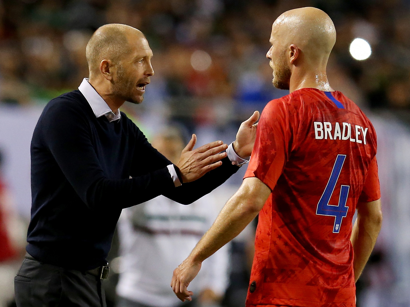 Gregg Berhalter and Michael Bradley talk during the Gold Cup final