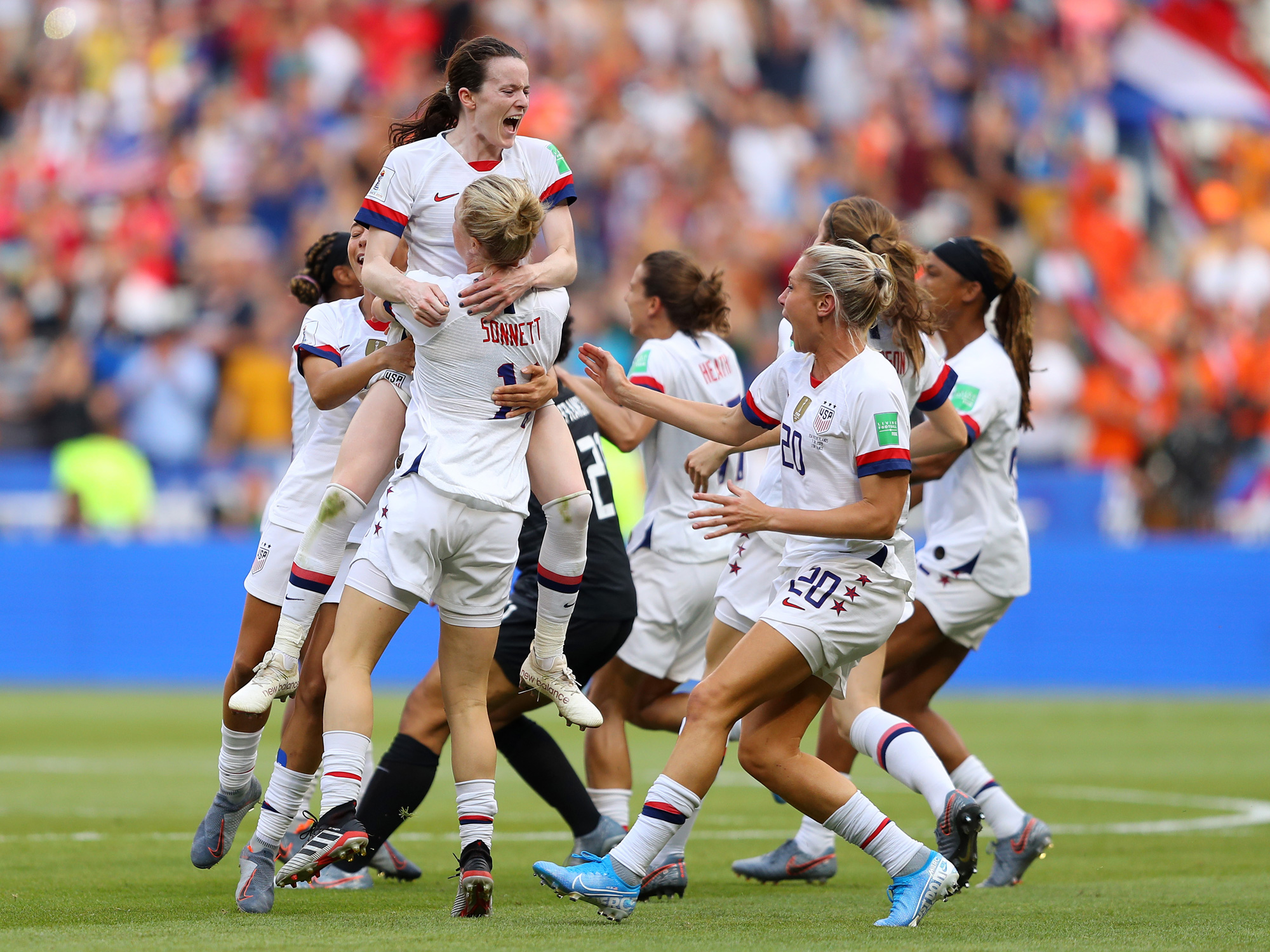 Rose Lavelle is mobbed by her USA teammates after scoring in the Women's World Cup final