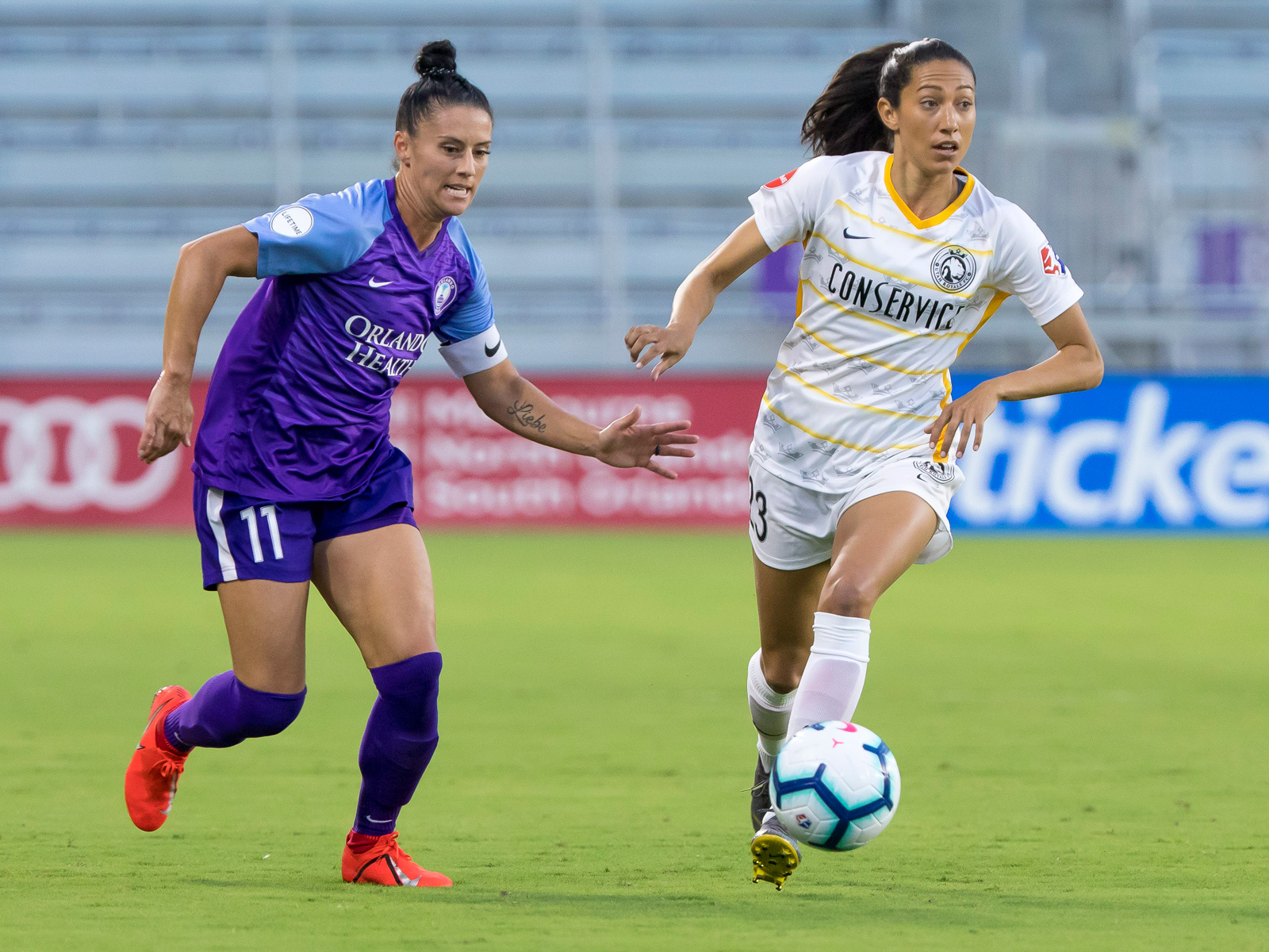 Ali Krieger and Christen Press play in the NWSL