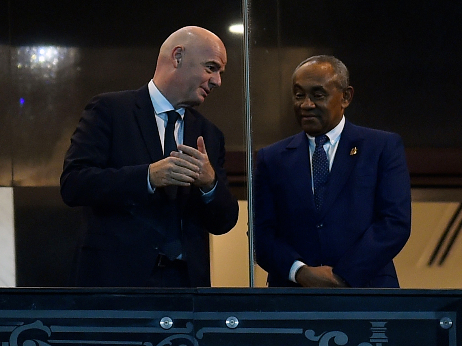 FIFA president Gianni Infantino, left, and Confederation of African Football president Ahmad Ahmad speak at the Africa Cup of Nations final.