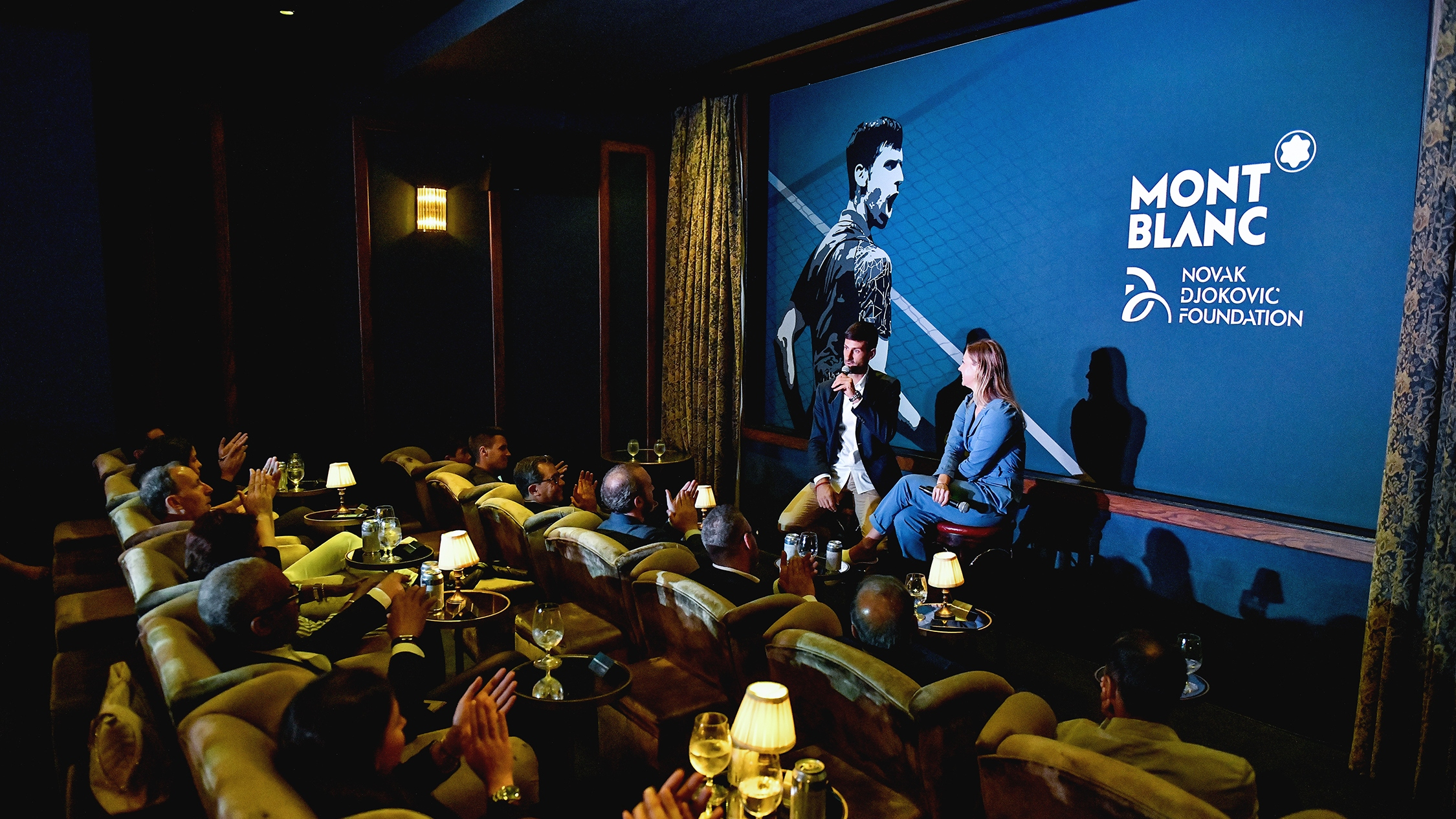 Novak Djokovic discusses a special-edition Montblanc pen at a private screening room in Chelsea.