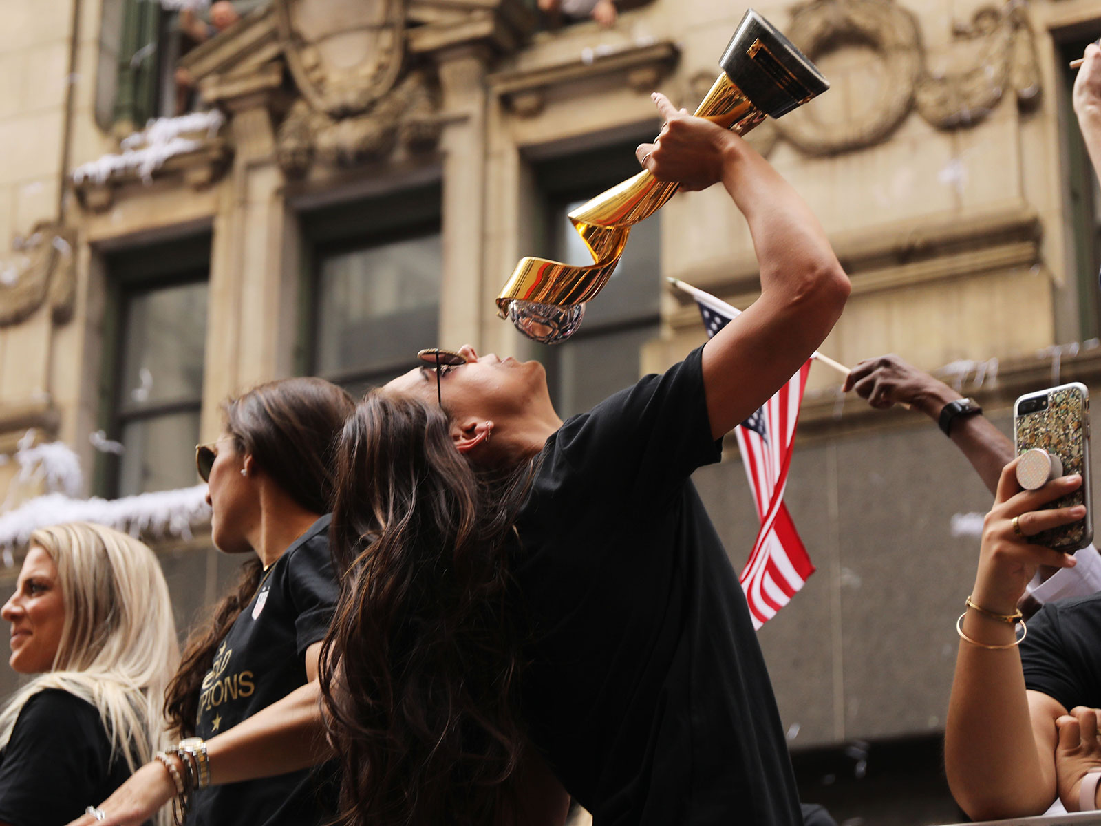 Alex Morgan celebrates during the USWNT's victory parade
