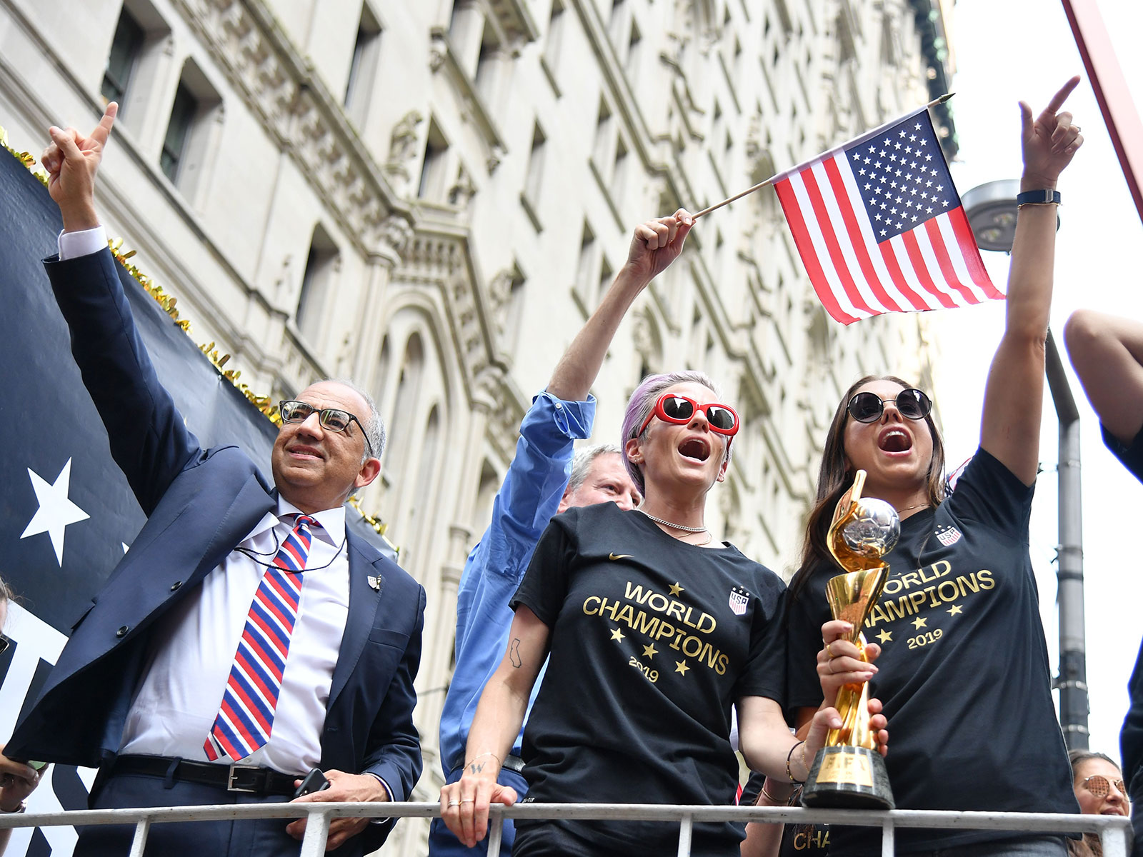 Carlos Cordeiro, Megan Rapinoe and Alex Morgan at the USWNT parade in New York City
