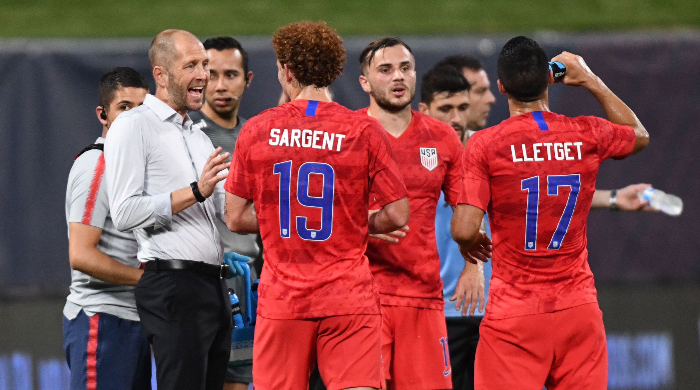 Gregg Berhalter talks to Josh Sargent in the USA's draw vs. Uruguay