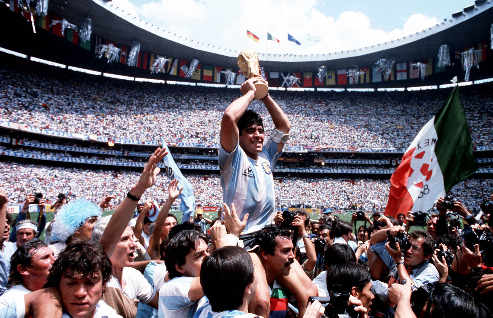 Diego Maradona lifts the World Cup trophy