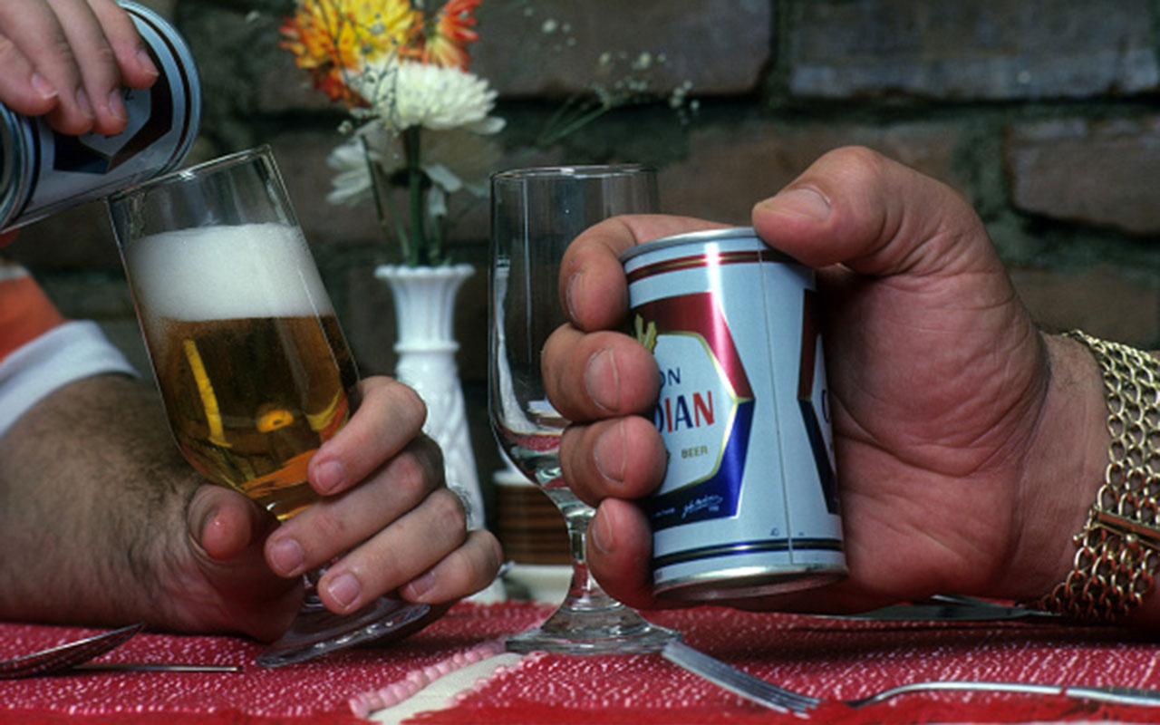 Andre the Giant holding a beer can.