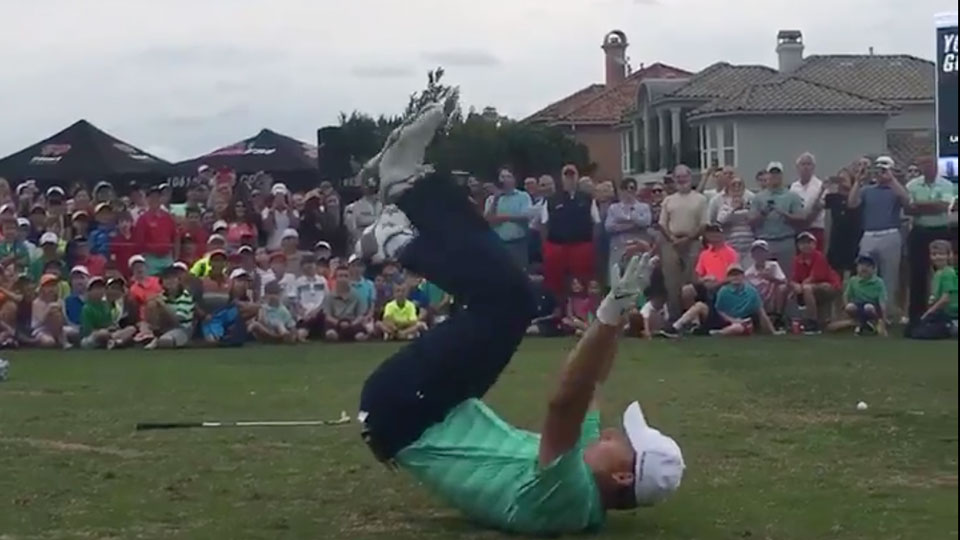 Jordan Spieth falls down after catching a marshmallow in his mouth after pulling off a fantastic trick shot.