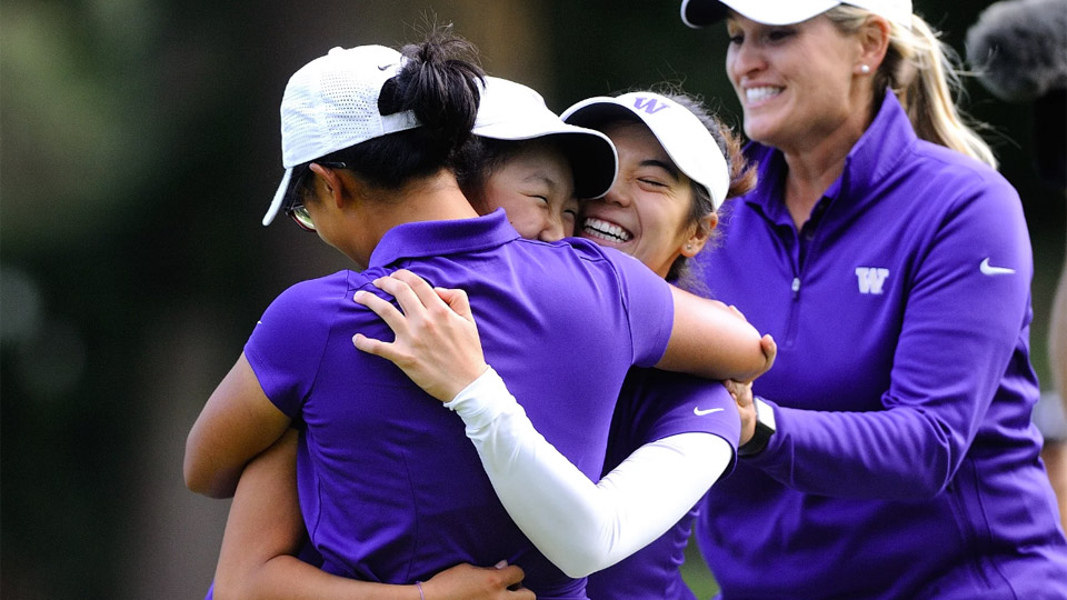 The Washington Huskies celebrate after their victory to advance to the NCAA Championship finals.