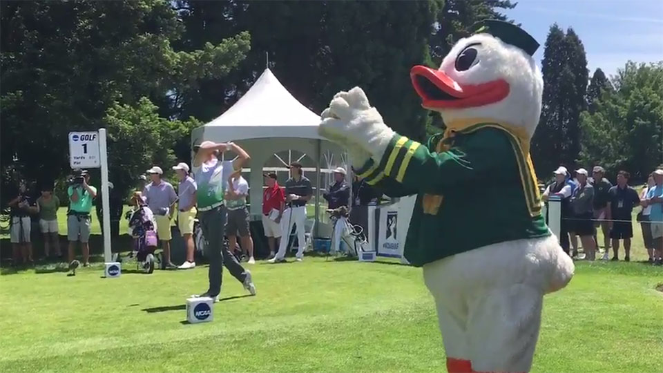 The Oregon Duck cheers on Oregon's Aaron Wise as he tees off Monday at the NCAA Championship.