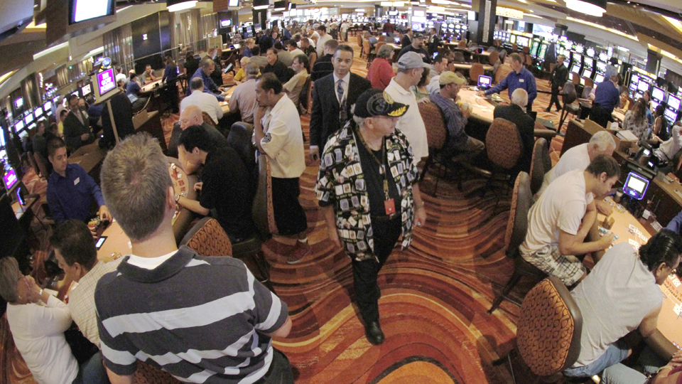 Patrons gamble at table games in the Rivers Casino in Pittsburgh.