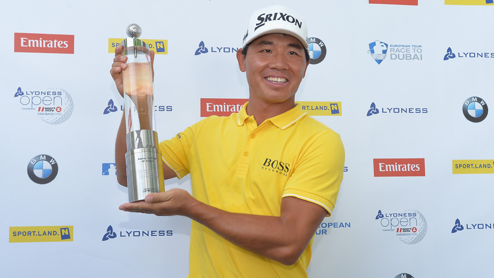 Ashun Wu of China celebrates with the trophy after winning the Lyoness Open Sunday.