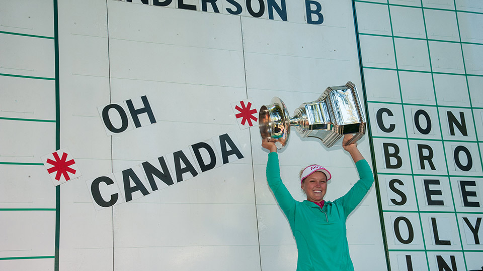 Brooke Henderson hoists her trophy after winning the 2016 KPMG Women's PGA Championship.