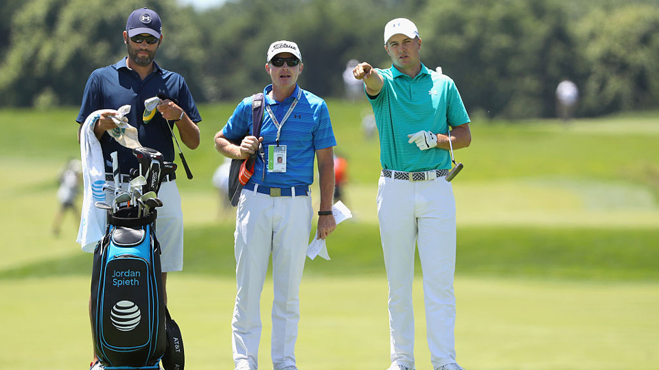 Jordan Spieth (right), caddie Michael Greller (left) and coach Cam McCormick (middle) size up a shot during Spieth's practice round Monday.