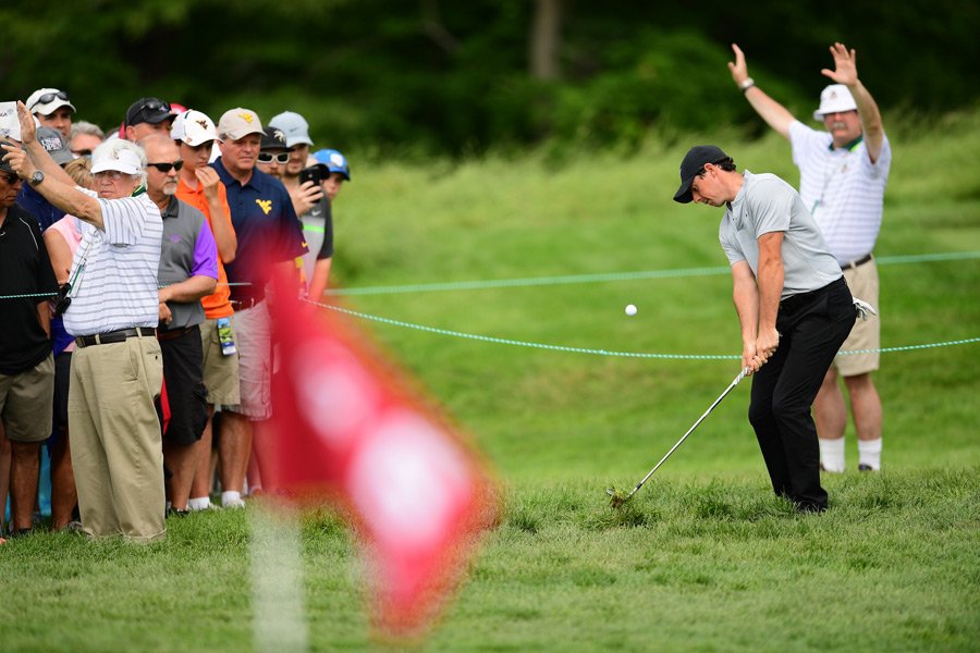 McIlroy does battle with the thick rough at Oakmont.