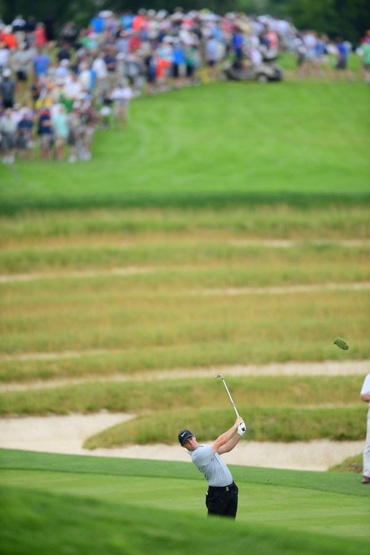 Rory McIlroy hits an iron shot during round 1.