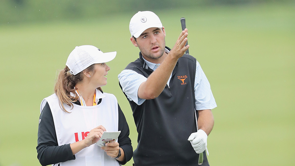 Amateur Scottie Scheffler talks with his caddie and sister Callie Scheffler during the first round of the U.S. Open at Oakmont Country Club on June 16, 2016 in Oakmont, Pennsylvania.