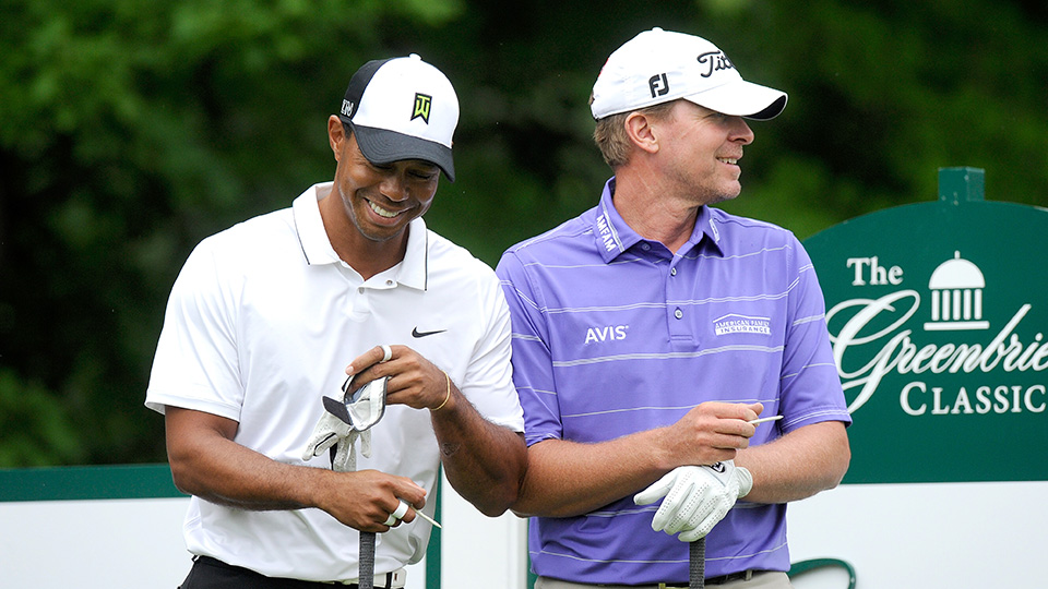 Tiger Woods and Steve Stricker wait to tee off on the 12th hole during the second round of the 2015 Greenbrier Classic.