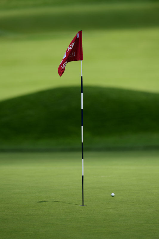 A ball sits near the hole during Friday play at Oakmont.
