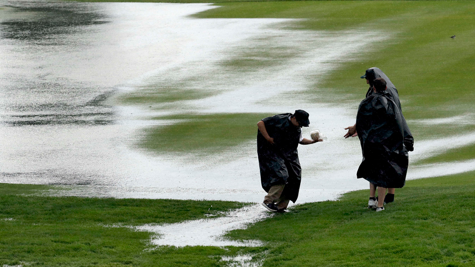 Fans get caught in the torrent of rain that hit Oakmont Thursday, leaving the USGA scrambling to get the course in order.