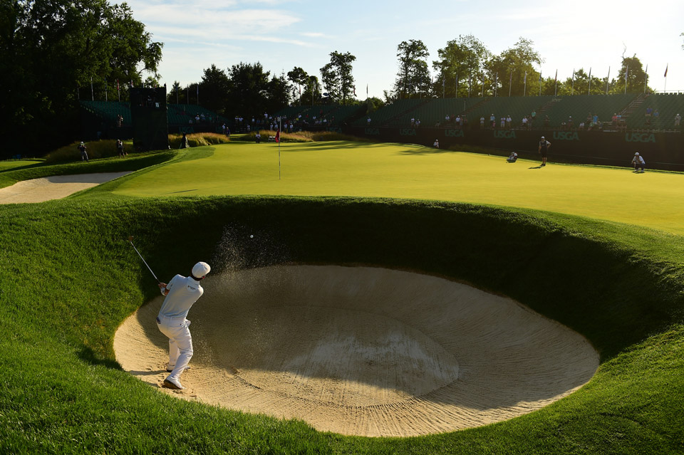 Andrew Landry escapes a bunker Sunday morning at Oakmont.