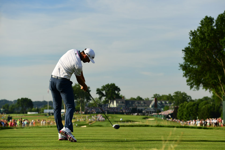 Dustin Johnson tees off on the 18th hole during the completion of his third round Sunday morning.