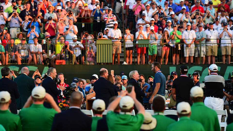 Jack Nicklaus was among those on the green to congratulate Dustin Johnson after his first major victory.