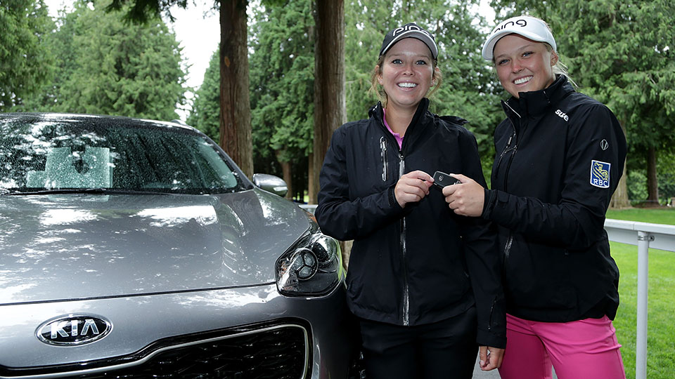 Brooke Henderson kept her promise to sister/caddie Brittany, posing next to Brittany's new Kia after Brooke made a hole in one on the 13th hole during the 2016 KPMG Women's PGA Championship.