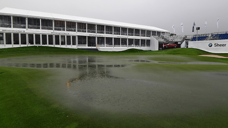 The flooded 18th green during the suspension of play during the third round of the 2016 BMW International Open.