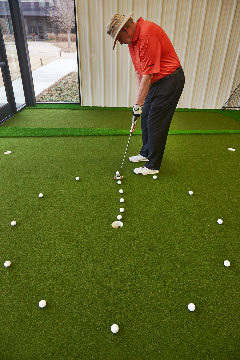 Roll straight putts from long range, then breaking three-footers. By focusing on the variables that influence roll, you'll improve your contact.