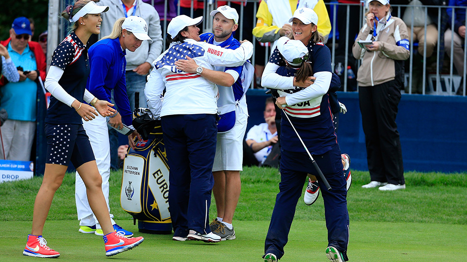 Angela Stanford is lifted in the air after her win against Suzann Pettersen, while Michelle Wie moves in to join the celebrations during 2015 Solheim Cup.