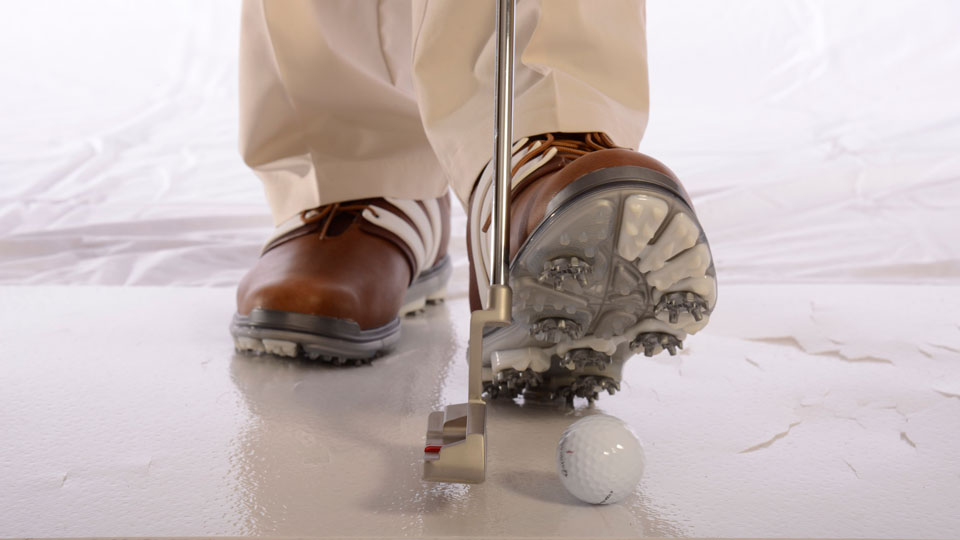 Strike the ball and your foot at the same time to fix a yippy stroke.