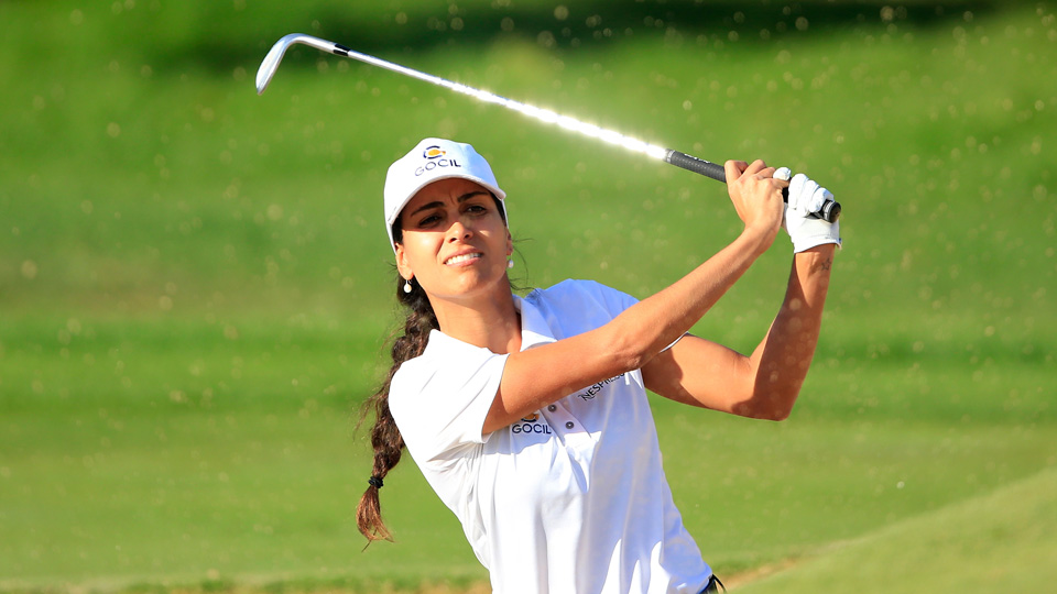 Victoria Lovelady of Brazil plays her third shot on the par 4, first hole during the second round of the 2015 Omega Dubai Ladies Masters.