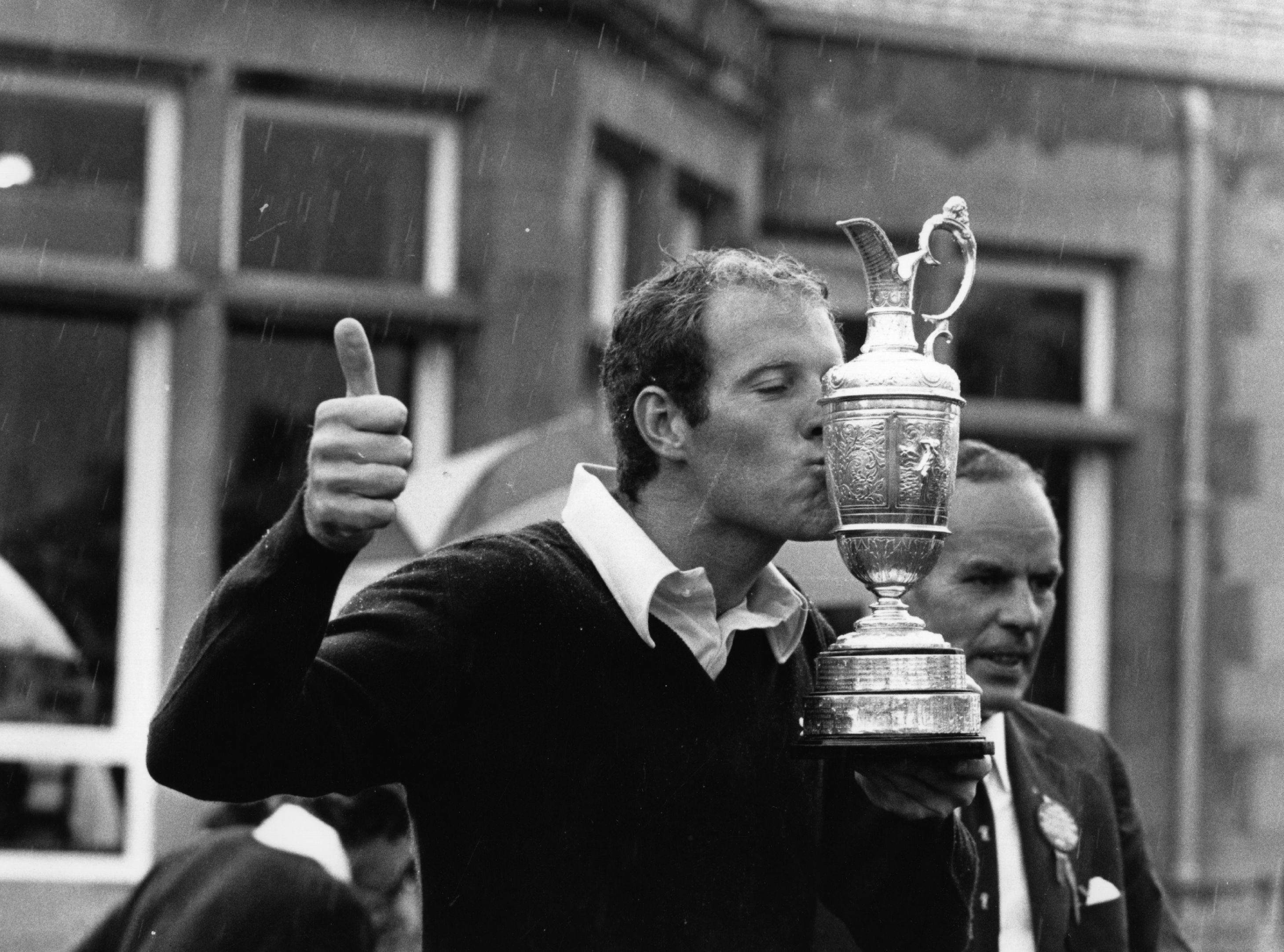 Tom Weiskopf, American golfer who acquired the nickname 'Towering Inferno' because of his height and his fits of anger, kissing the British Open Championship trophy.