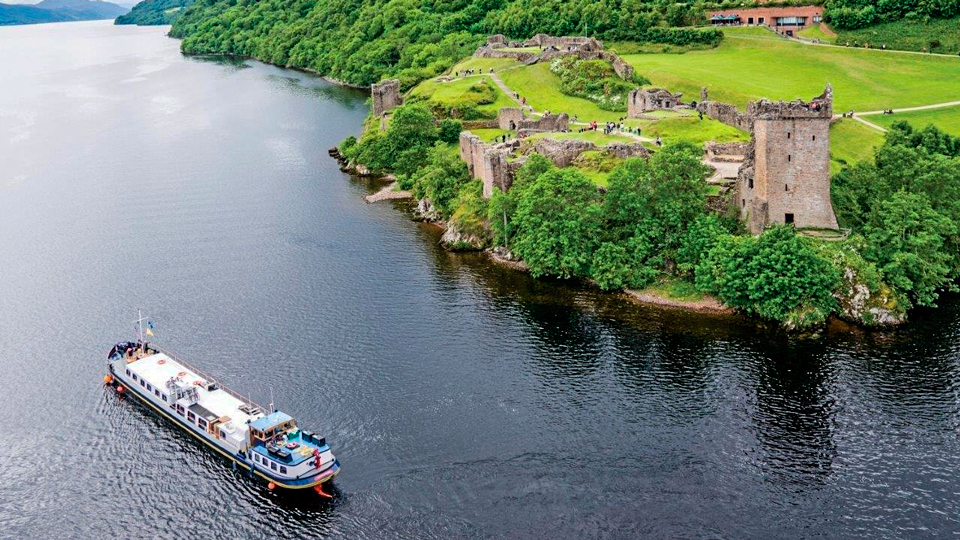 On the Great Glen Barge Cruise, spend too much time eyeing Urquhart Castle and you'll miss what lies beneath--in Loch Ness.