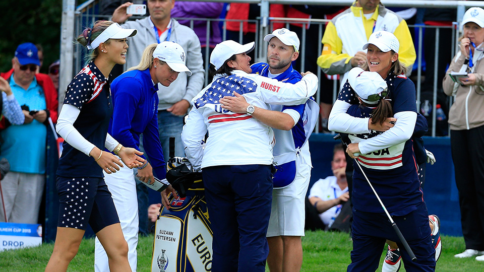 Michelle Wie joins Angela Stanford to celebrate her win over Suzanne Pettersen during the final day singles matches at the 2015 Solheim Cup.