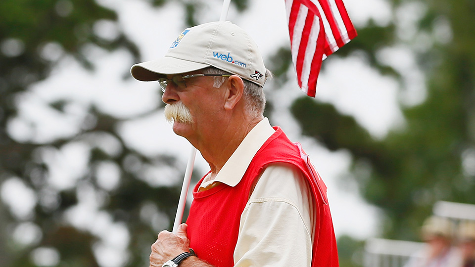 """Caddie Mike """"Fluff"""" Cowan waits on the 16th green during the final round of the 2014 Tour Championship."""