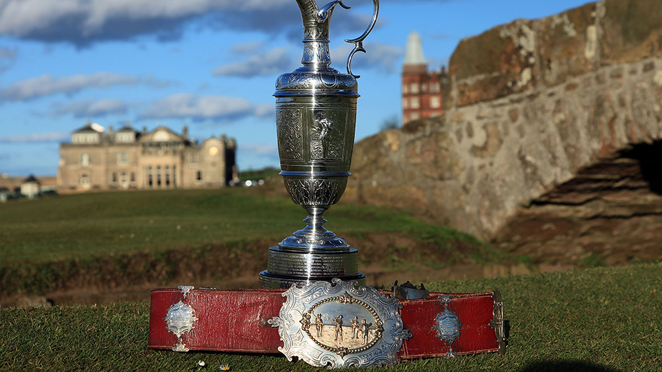 The Open Championship trophy with the original Champion Belt awarded to the early winners of the Championship.