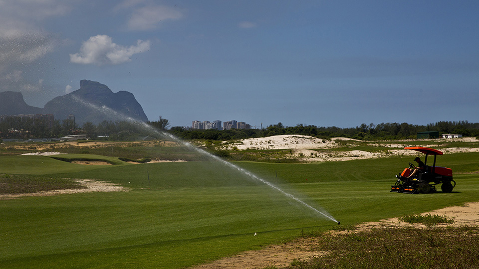A worker mows grass on the Olympic golf course in Rio de Janeiro, Brazil.
