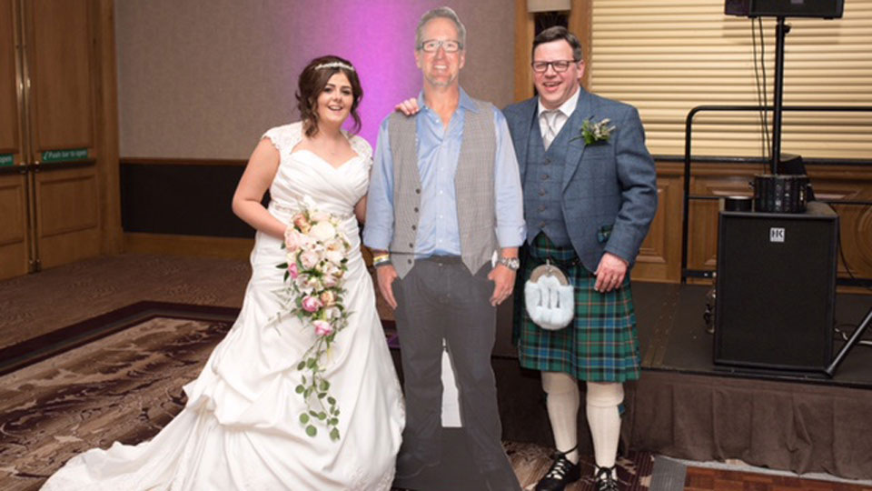 Kirsty and Stuart Gow with the guest of honor at their 2016 wedding.