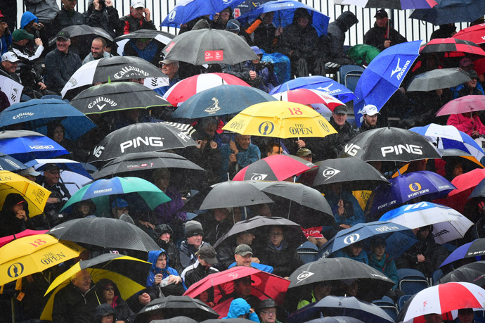 Spectators needed umbrellas to put up with the rain and wind that pounded the course during the second round.